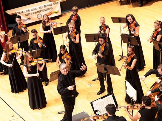 George Thomson conducts West Salem's string orchestra