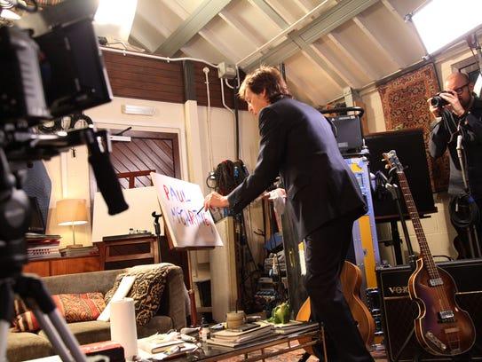 Paul McCartney works in his home studio in England.