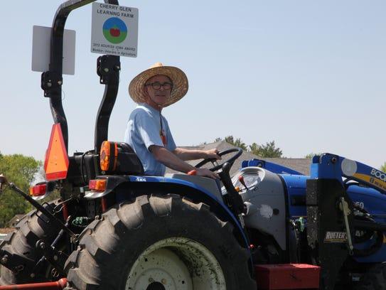 Ray Meylor, owner of Cherry Glenn Learning Farm, spreads