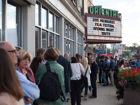 Moviegoers line up for the opening-night screening