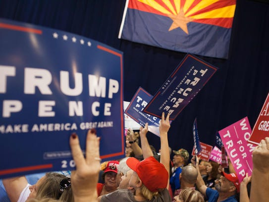 Trump supporters arrive at a rally in Phoenix on Oct.