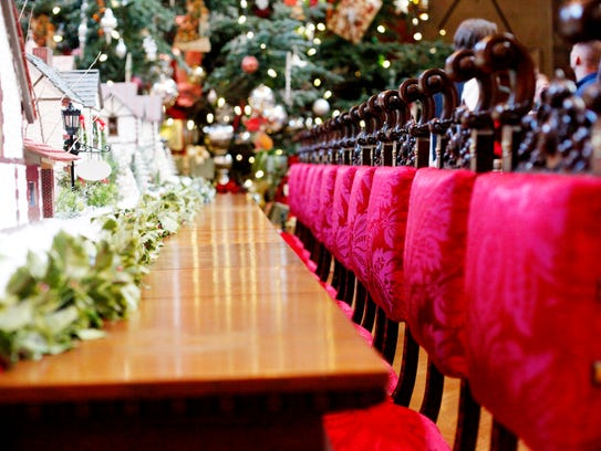 A row of chairs lines the long dining room table at