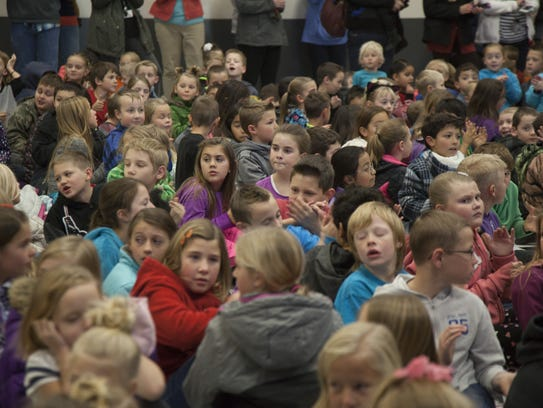 Students crowd the auditorium at Hurricane Elementary
