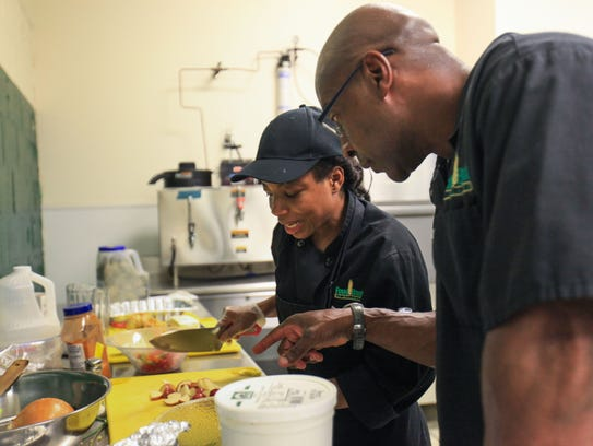 Food Bank of Delaware executive chef Tim Hunter, right,