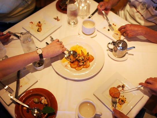 Customers dine at IM Tapas on April 30, 2014. Chef-owners