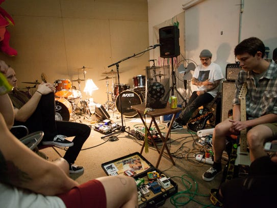 Members of NVM rehearse in their practice space in