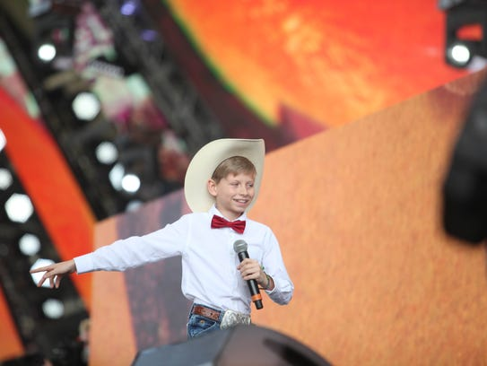 Mason Ramsey performs on stage with Whethan on Friday