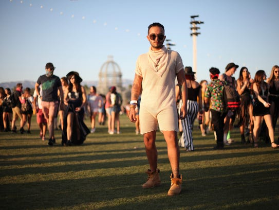 "A man poses in a nude colored ""romphim"" at Coachella"