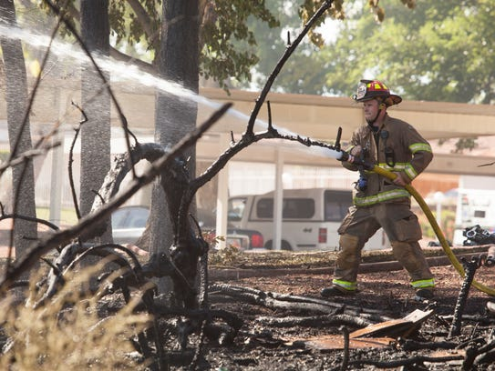 A brush fire near Springtree Garden Apartments threatens