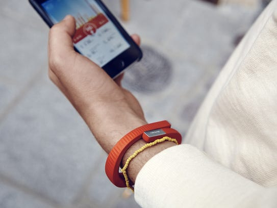 The Jawbone UP computer or smartphone-connected fitness