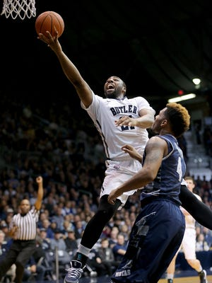 Butler's Roosevelt Jones is fouled by Georgetown's D'Vauntes Smith-Rivera while he attempts a shot during the first half of a game on March 3, 2015 at Hinkle Fieldhouse. Georgetown won 60-54.