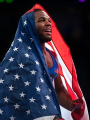 Jordan Burroughs celebrates after winning the gold medal on the final day of the 2015 World Wrestling Championships at The Orleans Arena in Las Vegas.