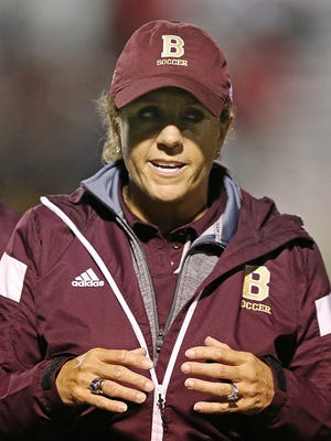 Brebeuf Jesuit Braves head coach Angela Berry White talks to the team at half time during soccer regionals between Brebeuf Jesuit and North Central at Carmel High School, Wednesday, October 12, 2016.