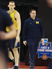 Michigan Wolverine assistant coach Billy Donlon watches practice for their first round NCAA tournament game against Oklahoma State on Thursday March 16, 2017 at Bankers Life Fieldhouse in Indianapolis.