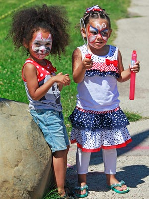 Cousins Alaine Cannizzaro (left), 3, and Lexi Cannizzara, 5, dressed in red, white and blue outfits along with painted faces to match, were at the lakefront with grandmother Lisa Cannizzaro for the fireworks.