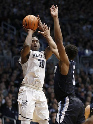 Butler Bulldogs forward Kelan Martin (30) shoots a three-pointer over Villanova Wildcats guard Phil Booth (5) in the first half of their game at Hinkle Fieldhouse Saturday, Dec. 30, 2017.