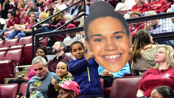 Young fans hold up a cardboard cut-out of Brittany Brown (12) during the third quarter against Lousiville.The Seminoles defeated the Cardinals 72-65 on Thursday, Janurary 12th.