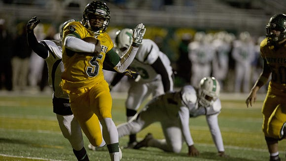 Rico Dowdle scored seven touchdowns in Friday's 71-28 home win over Gastonia Ashbrook.