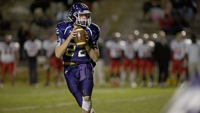 Mitchell quarterback Ben Young is a 1,000-yard passer for the 1-AA Western Regional champions.