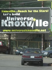 A billboard supports Universe Knoxville along Kingston