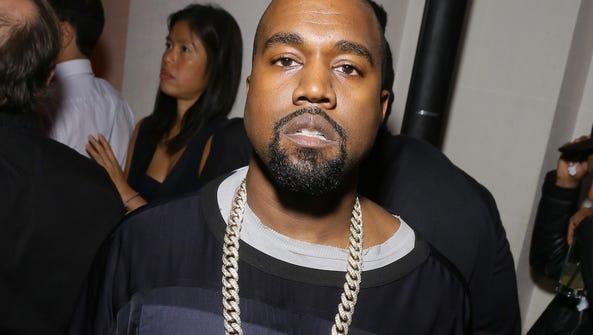 PARIS, FRANCE - OCTOBER 03: Kanye West attends Vogue