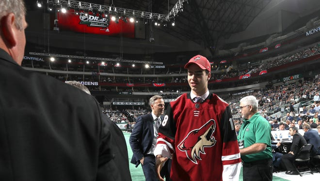 Kevin Bahl reacts after being selected 55th overall by the Arizona Coyotes during the 2018 NHL Draft at American Airlines Center on June 23, 2018 in Dallas, Texas.