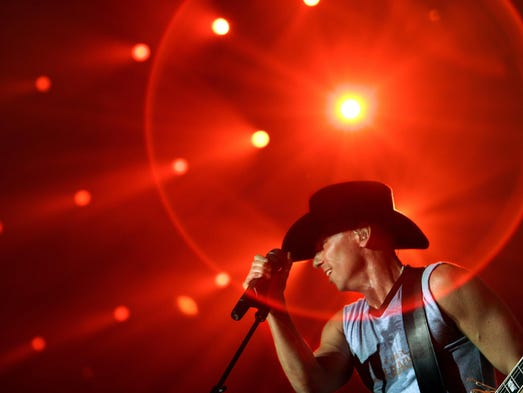 Kenny Chesney performs at in Evansville, Ind. at Roberts Stadium in 2006.