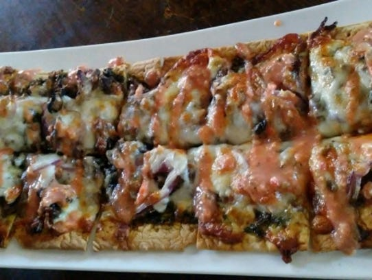 1.2.1 Tapas'  Texan flatbread was a crispy rectangle