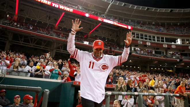 Former Reds shortstop Barry Larkin recognizes the crowd during postgame commemorations of the 1990 World Series Championship team, Friday, April 24, 2015, at Great American Ball Park in Cincinnati.