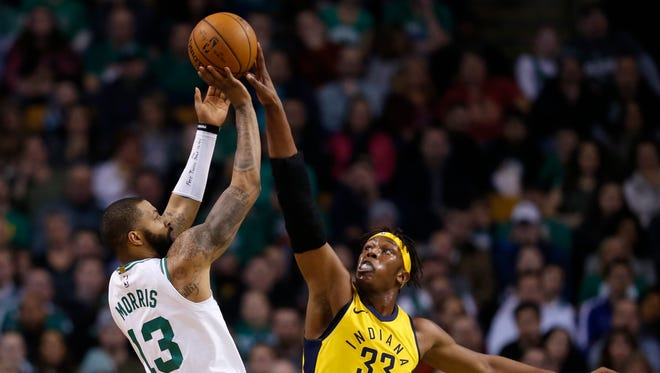 Boston Celtics forward Marcus Morris (13) is defended by Indiana Pacers forward Myles Turner (33) during the first half at TD Garden.