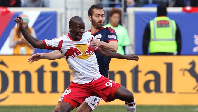 New England Revolution defender A.J. Soares (5) defends against New York Red Bulls forward Bradley Wright-Phillips (99) during the first half of the Eastern Conference Championship at Red Bull Arena.