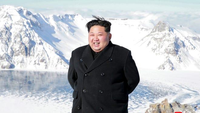 North Korean leader Kim Jong Un smiles as Kim climbed Mt. Paektu, Ryanggang Province, North Korea.