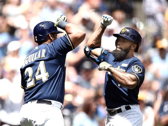 Eric Thames and Jesus Aguilar bash forearms following a home run against the Los Angeles Dodgers at Miller Park on June 4.