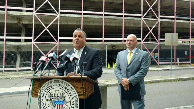 Binghamton Mayor Richard David and State Sen. Fred Akshar held a joint press conference Monday to discuss the Collier Street parking ramp.