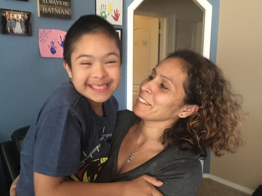Donovan Gutierrez, 10, smiles with his mom Katherine Gutierrez at their home in Spanish Springs. Witness statements from staff at Alyce Taylor allege the boy was abused by a teacher's aide at school.