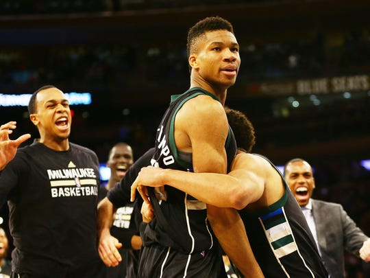 Giannis Antetokounmpo is congratulated after scoring the winning basket at the buzzer against the New York Knicks at Madison Square Garden. The Bucks won, 105-104.