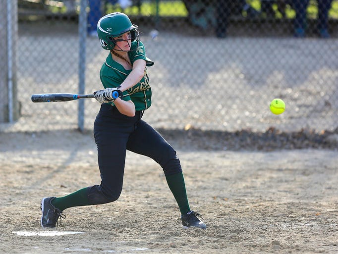 Laconia's Mckayla Johnson swings at a pitch during