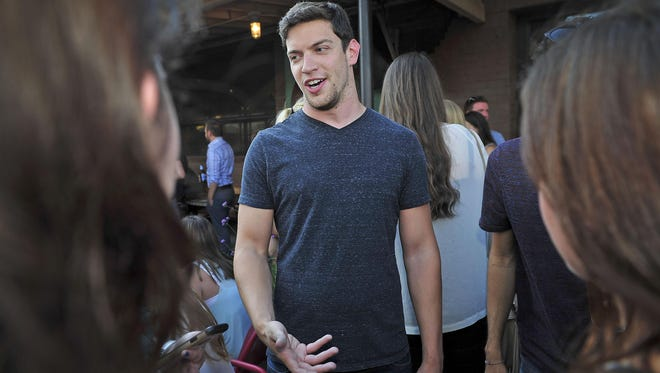 Andrew Cohen talks with people during a Young Entertainment Professionals gathering at M.L. Rose Craft Beer & Burgers on Monday, June 29.