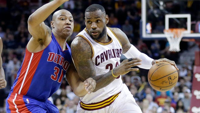 Cleveland Cavaliers' LeBron James, right, drives on Detroit Pistons' Caron Butler on April 13, 2015, in Cleveland. The Cavaliers are a No. 2 seed in the Eastern Conference and face the Boston Celtics in the first round of the playoffs.