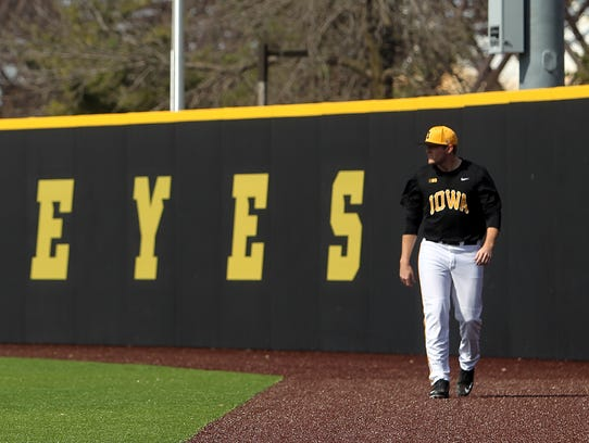 Iowa pitcher C.J. Eldred warms up before the Hawkeyes'