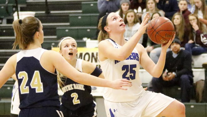 Jess Schiefen of Horseheads goes in for a layup Tuesday as Elmira Notre Dame's Taylor Van Dine (24) and Maura Glovins defend during the Blue Raiders' victory in a girls quarterfinal game at the Josh Palmer tournament at Elmira High School.