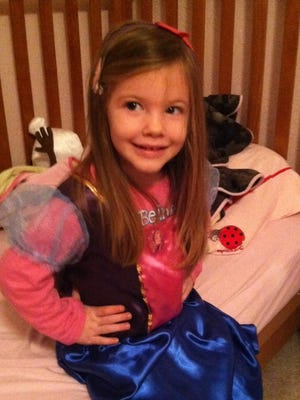"""Ayzlee McCarthy, 3, on Dec. 26 shows off a Princess Anna (from the Disney movie """"Frozen"""") dress she got for Christmas. Ayzlee woke up ill Dec. 27. Two days later, she died from complications from influenza, her family said. The family lives in Elk Horn. Ayzlee died at Blank Children's Hospital in Des Moines."""