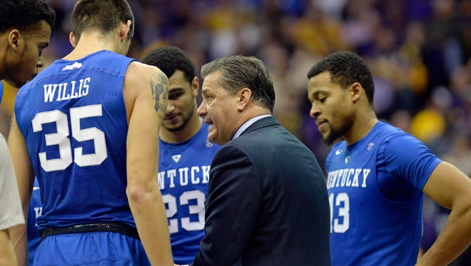 Kentucky head coach John Calipari talks to his players, including Kentucky forward Derek Willis (35), Kentucky guard Jamal Murray (23) and Kentucky guard Isaiah Briscoe (13), during a timeout in the second half of an NCAA college basketball game in Baton Rouge, La., Tuesday, Jan. 5, 2016. LSU won 85-67.