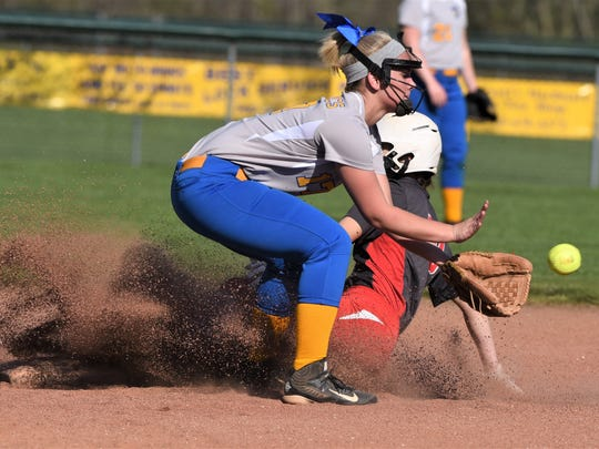Sheridan's Taylor Pagan slides into second base ahead of the ball, as Philo's Camber Revennaugh catches it. Philo won 6-5 in nine innings on Tuesday.