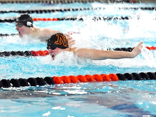 Northville's Jason Nitkiewicz (bottom) excels in the 100-yard butterfly.