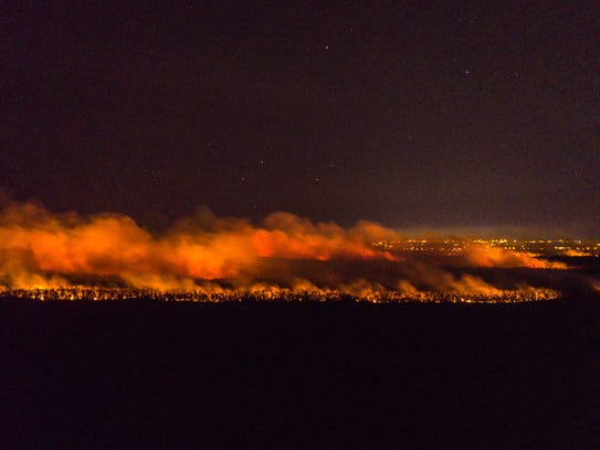 The Greenway Fire burns in Collier County on Thursday,