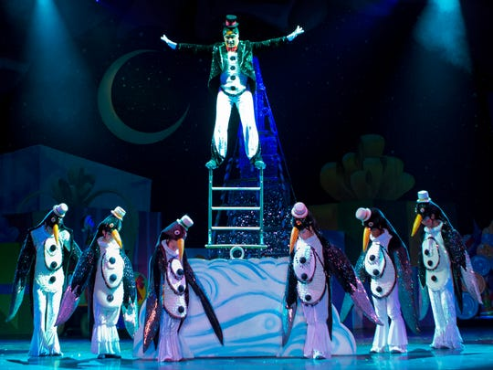 "A penguin balancing act in ""Cirque Dreams Holidaze"""