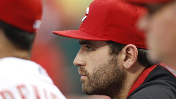 Reds first baseman Joey Votto sits in the dugout during a July 25 game against the Washington Nationals at Great American Ball Park.