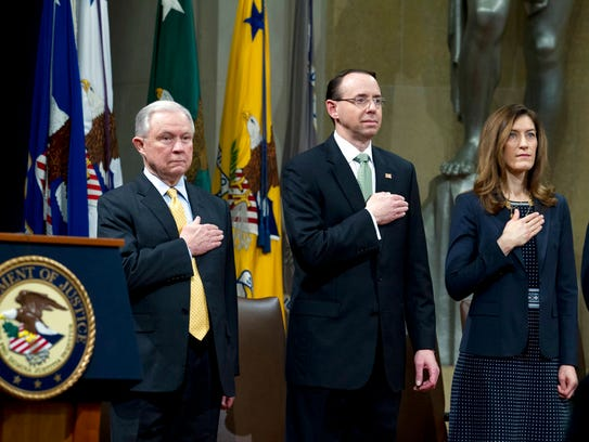 Attorney General Jeff Sessions accompanied by Deputy