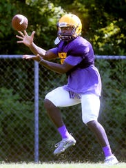 Smyrna's Jordan Carter makes a catch during practice
